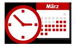 Uhr mit Kalenderblatt im Hintergrund